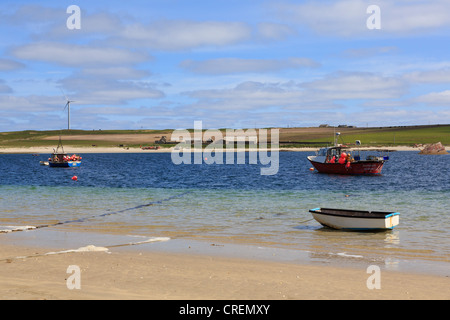 View across Weddell Sound to Burray Island with fishing boats from Glimps Holm beach, Orkney Islands, Scotland, - Stock Photo