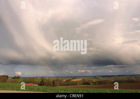 dark rain clouds and rain bow over the alpine upland, Germany, Bavaria, Oberbayern, Upper Bavaria - Stock Photo