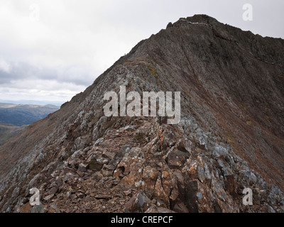A view along the north ridge of Crib Goch, Snowdonia, showing the east ridge coming in from the left and the main - Stock Photo