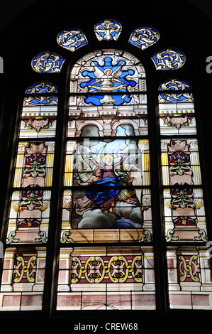 Stained glass window at Sainte-Anne-d'Auray basilica Morbihan Brittany in north-western France. - Stock Photo
