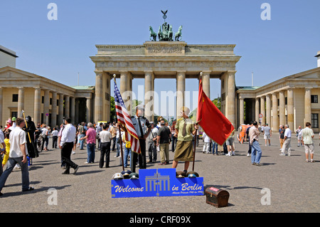 tourists in front of Brandenburg Gate, Germany, Berlin - Stock Photo