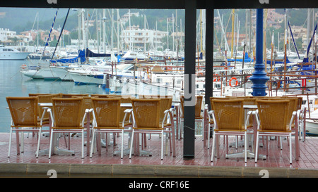 empty chairs in a cafe at a harbor, Spain, Majorca, Port Andratx - Stock Photo