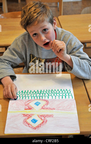 eight years old schoolboy drawing - Stock Photo