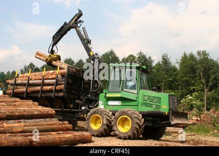 Norway spruce (Picea abies), forwarder handling spruce logs, Germany, North Rhine-Westphalia, Sauerland - Stock Photo