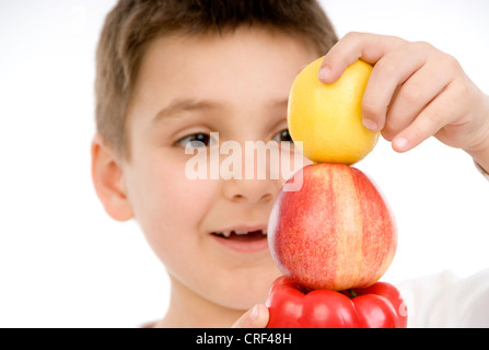 boy with pepper, apple and lemon - Stock Photo