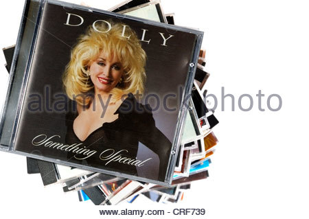 Dolly Parton 1995 album Something Special, piled music CD cases, England. - Stock Photo