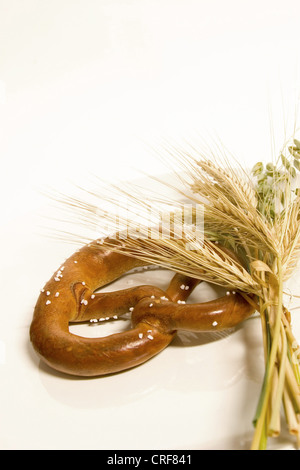 pretzel with a bunch of grain - Stock Photo