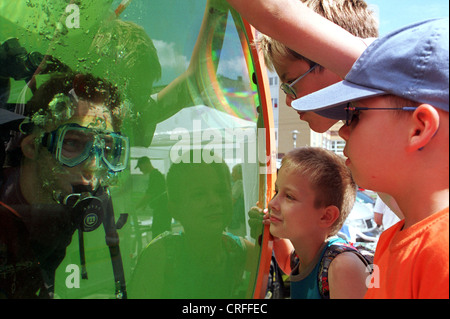 Berlin, Germany, children watch diver in a diving tower - Stock Photo