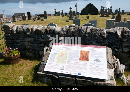 An interpretative sign at Cladh Mhuire chapel and graveyard on Benbecula in the Outer Hebrides - Stock Photo