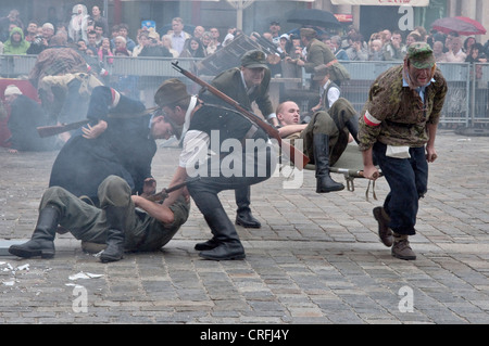 Home Army soldiers, carrying the wounded on a stretcher, 1944 Warsaw Uprising re-enactment at Rynek in Wrocław, - Stock Photo
