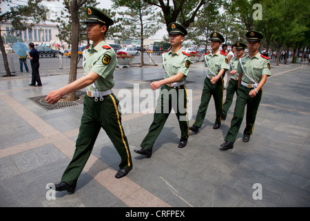 Members of the People's Liberation Army march past on Tiananmen Square. Part of a security detail in the city of - Stock Photo
