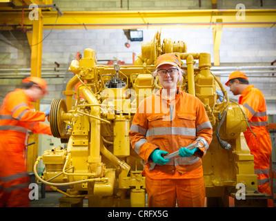 Apprentice engineer in factory - Stock Photo