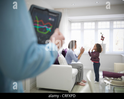 Mother and daughter playing together - Stock Photo