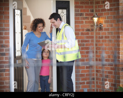 Energy worker talking to family - Stock Photo