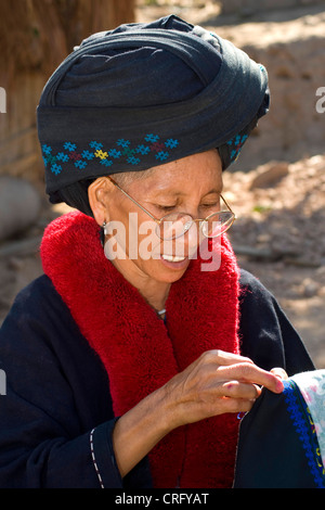 old woman wearing traditional clothing, Laos - Stock Photo