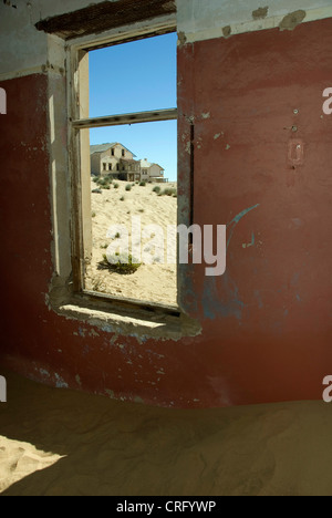 sand in a house of the abandoned diamond town Kolmanskop, Namibia, Luederitz - Stock Photo