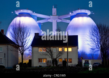 house in front of digestion tower of  waste water treatment plant Emscher, Germany, North Rhine-Westphalia, Bottrop - Stock Photo