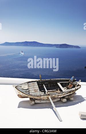 Weathered wooden boat on balcony - Stock Photo