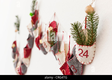 Close up of advent calendar on wall - Stock Photo