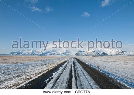 Rural road in snowy landscape - Stock Photo