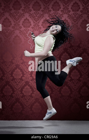 Woman listening to headphones in workout - Stock Photo
