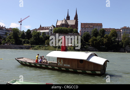 Ferry across the Rhine, Basel, Switzerland, Basel Cathedral in BG - Stock Photo