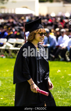 A happy young woman at her College graduation at CSU Channel Islands in Camarillo California - Stock Photo