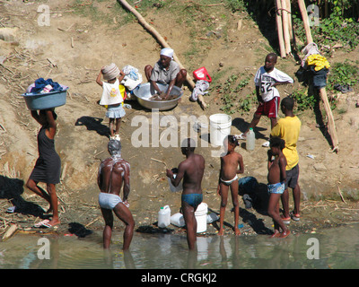 men having a bath in a river, women washing clothes, Haiti, Grande Anse, Jeremie - Stock Photo