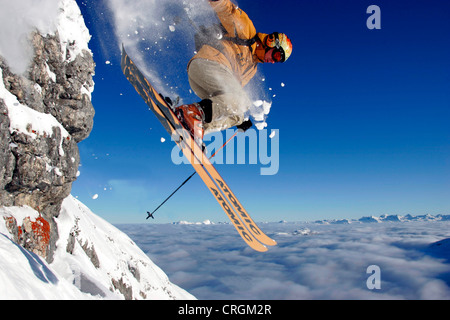 free riding in the Alps, skier jumping, Austria, Alps - Stock Photo