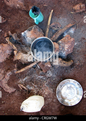 Simple fire place made of stones in rural area on which a soup is being heated, Haiti, Grande Anse, Jeremie - Stock Photo