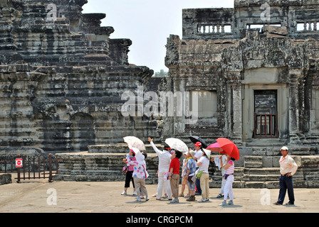 tourists in temple area of Angkor Wat, Cambodia - Stock Photo