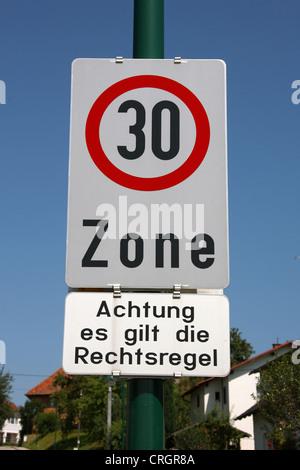 traffic sign: tempo 30 zone - Stock Photo