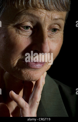 portrait of a thoughtfully elder woman - Stock Photo
