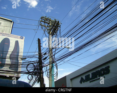 mess of electric cables and telephone wires, Panama, Colon - Stock Photo