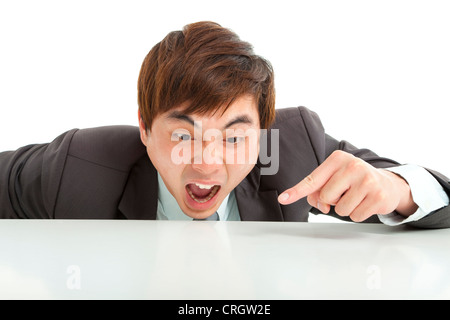 angry businessman pointing something on the table - Stock Photo