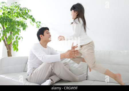Father playing with daughter - Stock Photo