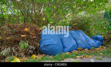garden rubbish in plastic bags - Stock Photo