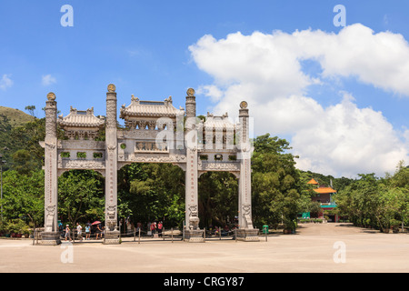Tourists at the main gate of Po Lin Monastery on Lantau Island, Hong Kong. - Stock Photo