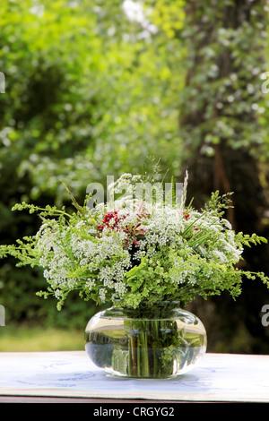 Bouquet of wildflowers in the garden in summer - Stock Photo