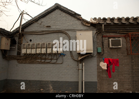 Electric meter boxes on exterior wall of a building, Hutong, Beijing, China, Asia - Stock Photo