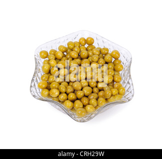 Preserved peas in crystal bowl isolated on a white background - Stock Photo