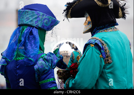 People wearing masks at the Carnival of Venice, Italy - Stock Photo