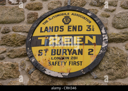An old AA information plaque on the wall of a farm building at Treen, St. Levan, Cornwall - Stock Photo