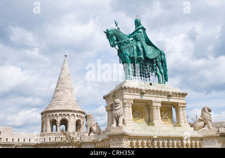 Statue of Saint Stephen in front of Fisherman's bastion at Buda castle in Budapest Hungary - Stock Photo