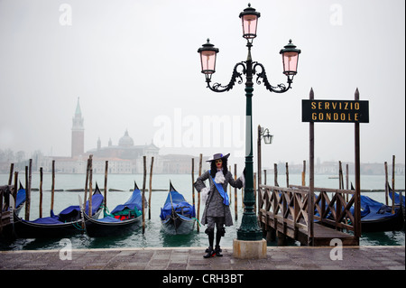 Person wearing mask at the Carnival of Venice, Italy - Stock Photo