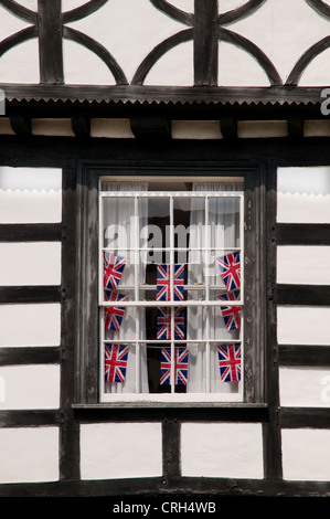 Window detail of medieval half timbered black and white building which survived the 1694 Warwick fire England - Stock Photo