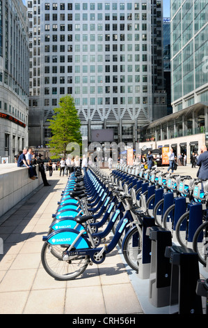 Barclays sponsored bikes for hire adjacent to Canary Wharf Jubilee Line underground station Isle of Dogs Tower Hamlets, - Stock Photo