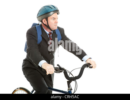 Businessman riding his bicycle to work, wearing a helmet and a backpack. Isolated on white. - Stock Photo