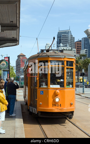 A refurbished vintage trolley from Milan stops at the Ferry Building along its Embarcadero route in San Francisco, - Stock Photo