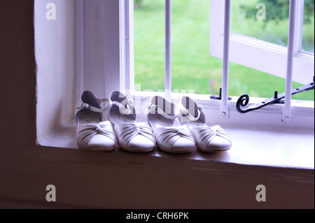 bridesmaids shoes on a windowsill - Stock Photo